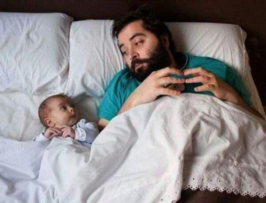 Like-Father-Like-Son-Relaxing-In-Bed